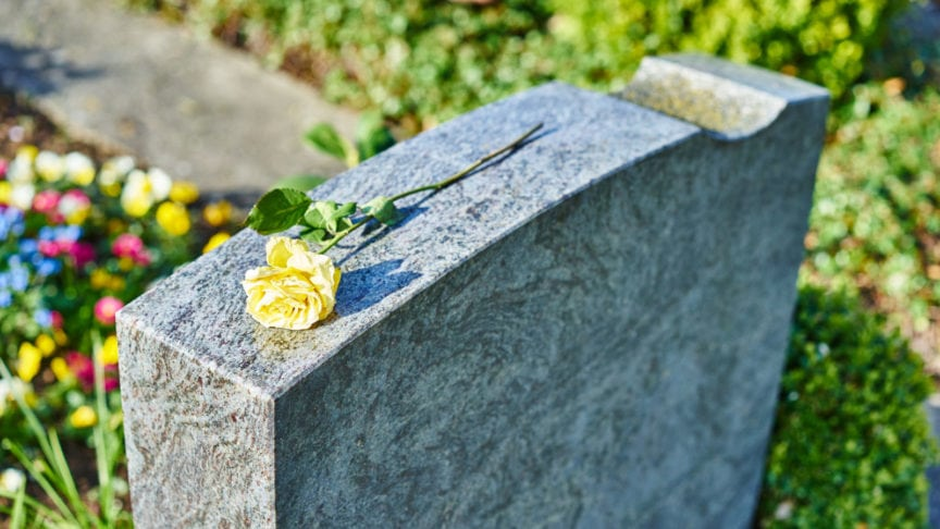 Yellow Rose Laying On A Headstone Stock Photo