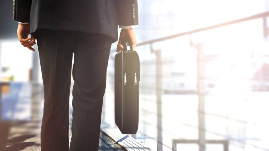 Insurance Adjuster Walking With A Briefcase Stock Photo