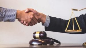 Lawyer Shaking Hands With New Client Stock Photo