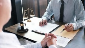 Lawyer Meeting With A New Client Privately Stock Photo