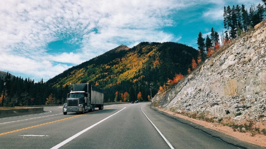 Large Semi-truck Driving In The Colorado Mountains
