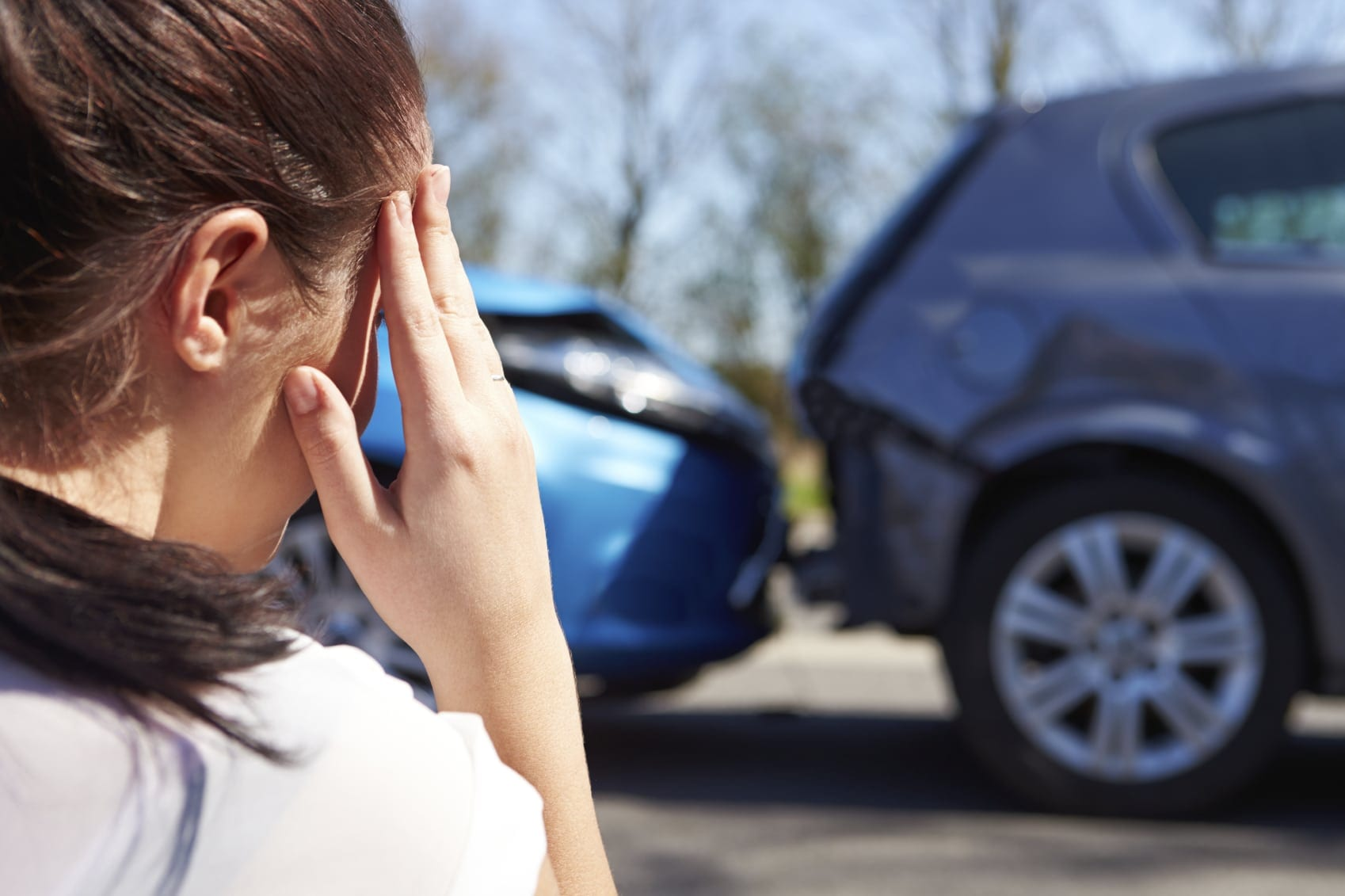 Woman With Worried Look After Rear-end Car Accident Stock Photo