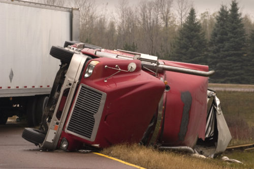 A semi-truck lying in the road after an accident in Colorado Springs.