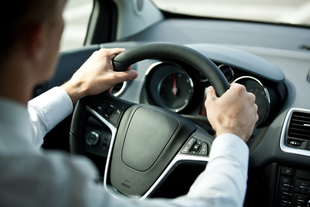 Man Driving Vehicle With Hands On Wheel Stock Photo