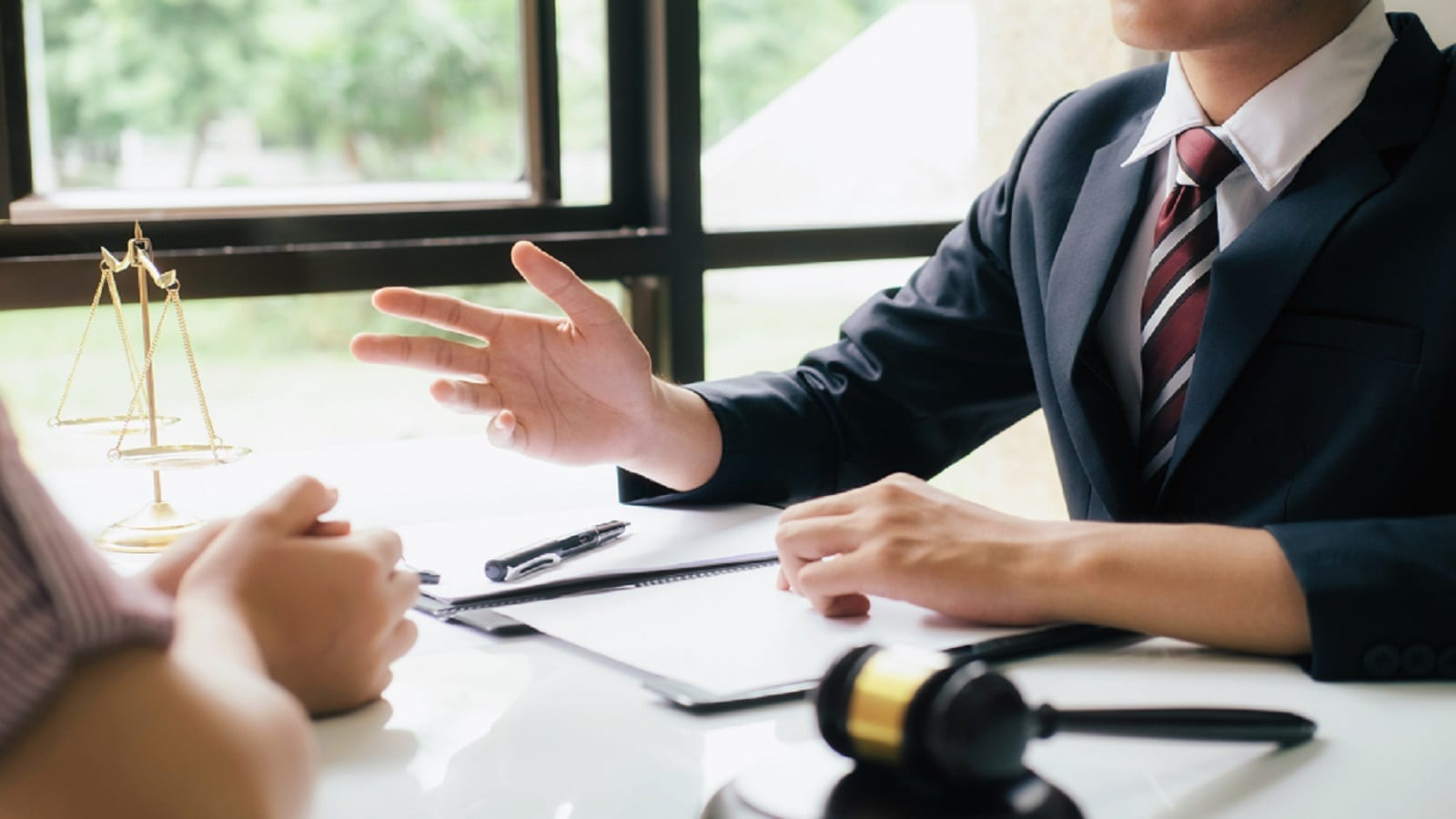 Lawyer Providing Legal Advice To A Client Privately Stock Photo