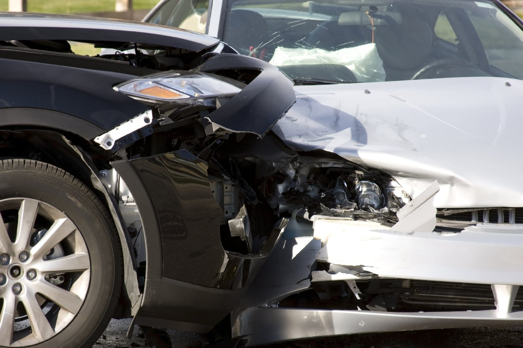 Auto Accident Between White And Black Vehicle Stock Photo