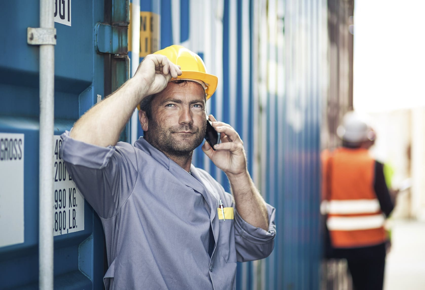 Construction Worker Talking On Smart Phone Stock Photo