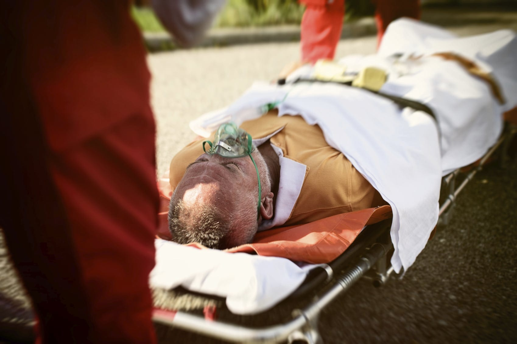 Man Being Loaded On Stretcher After Accident Stock Photo