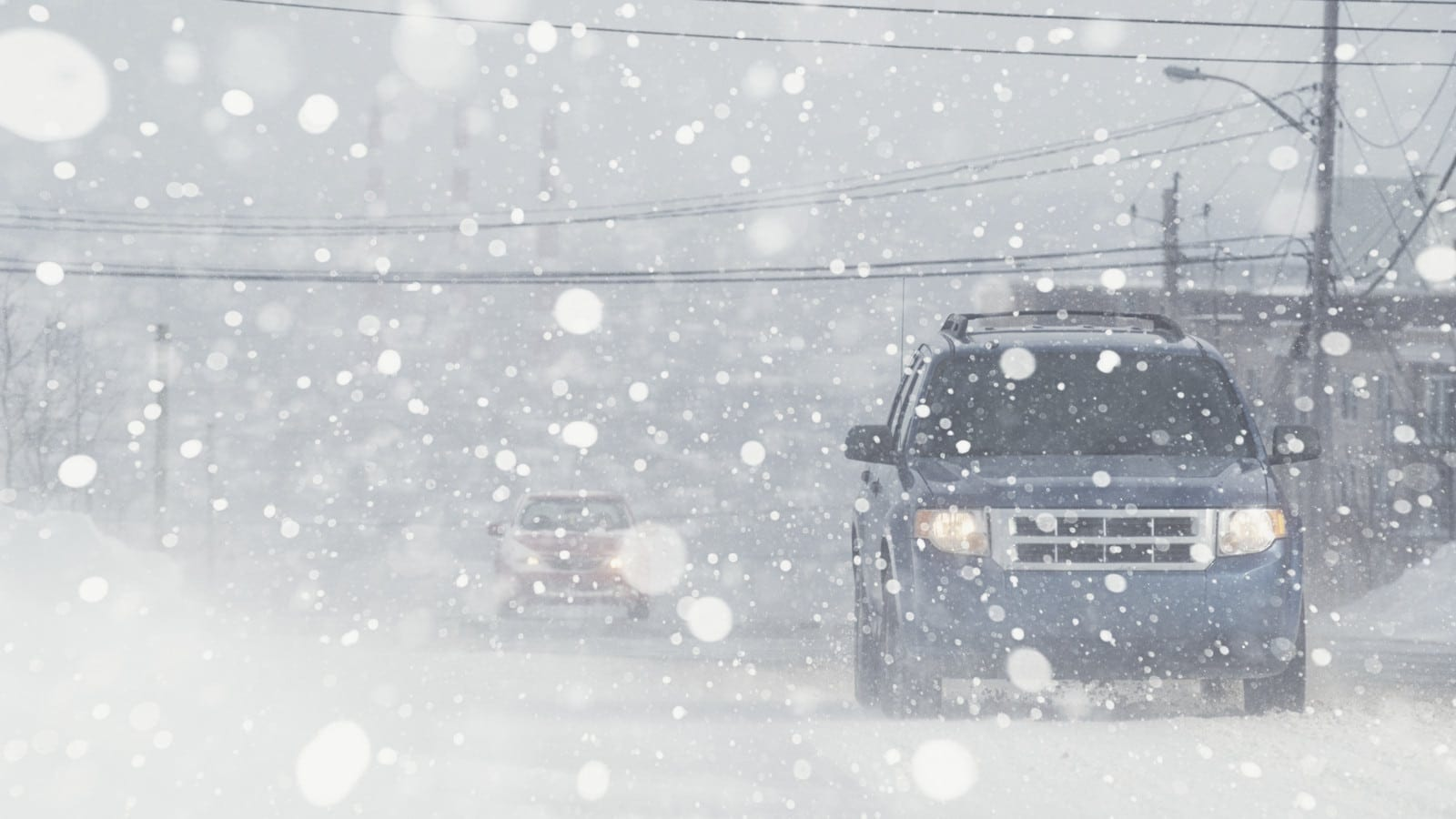 Cars Driving During Heavy Snowfall Stock Photo