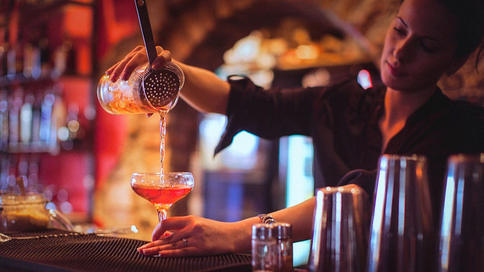 Female Bartender Making A Cocktail Stock Photo
