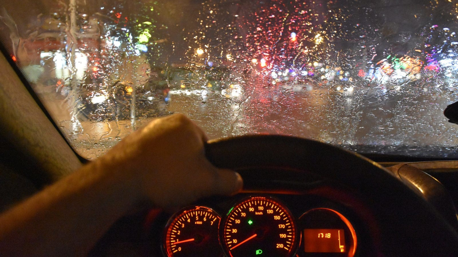 Man Driving His Vehicle During Heavy Rain Stock Photo