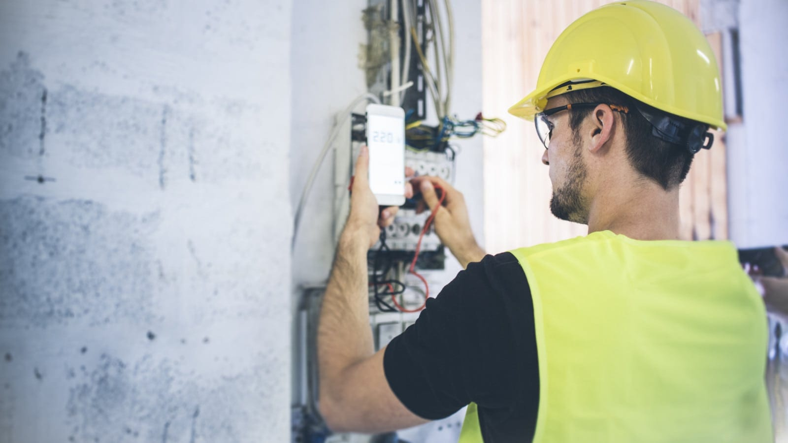Electrician In A Hard Hat Working Outdoors Stock Photo