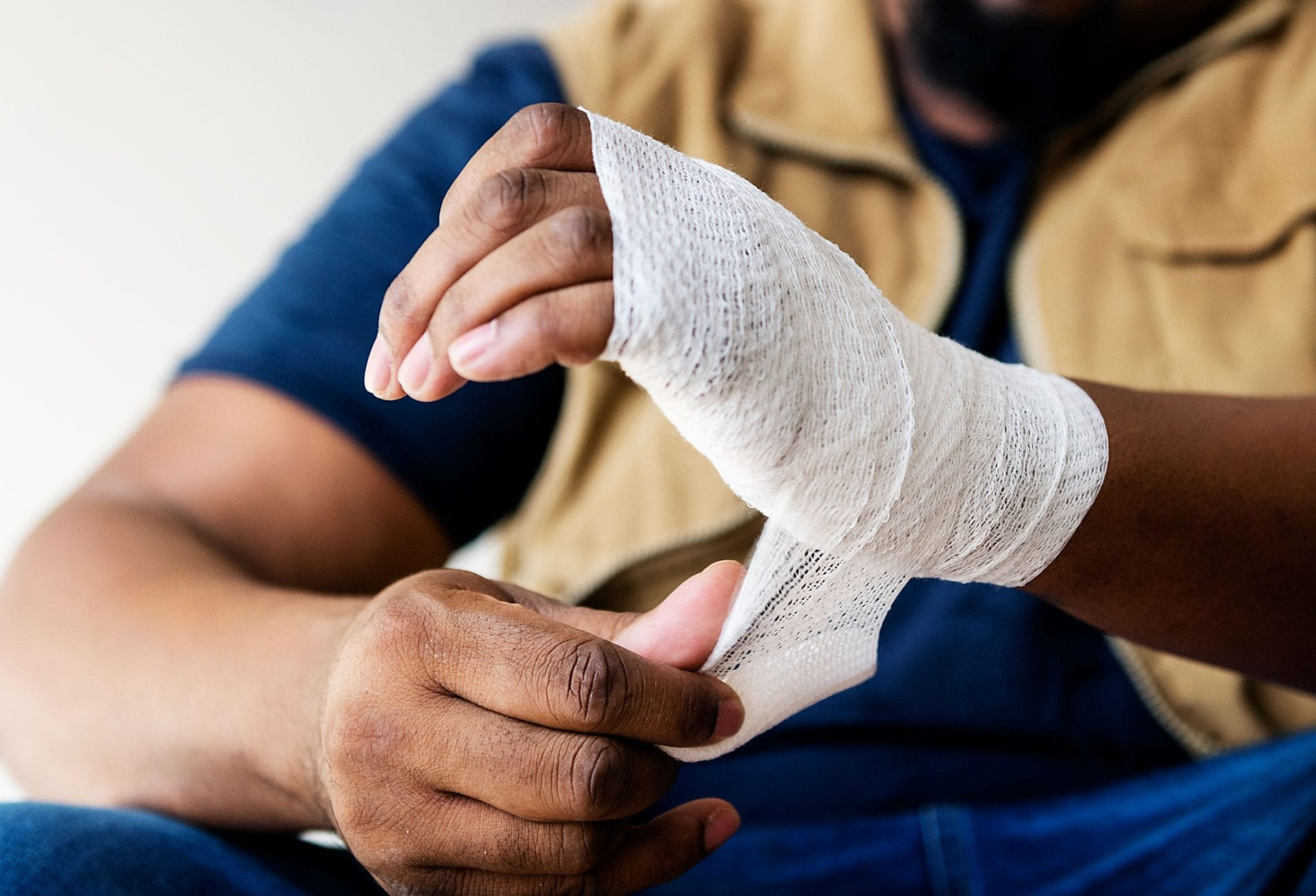 Man With Injured Hand Wrapped In Bandage Stock Photo