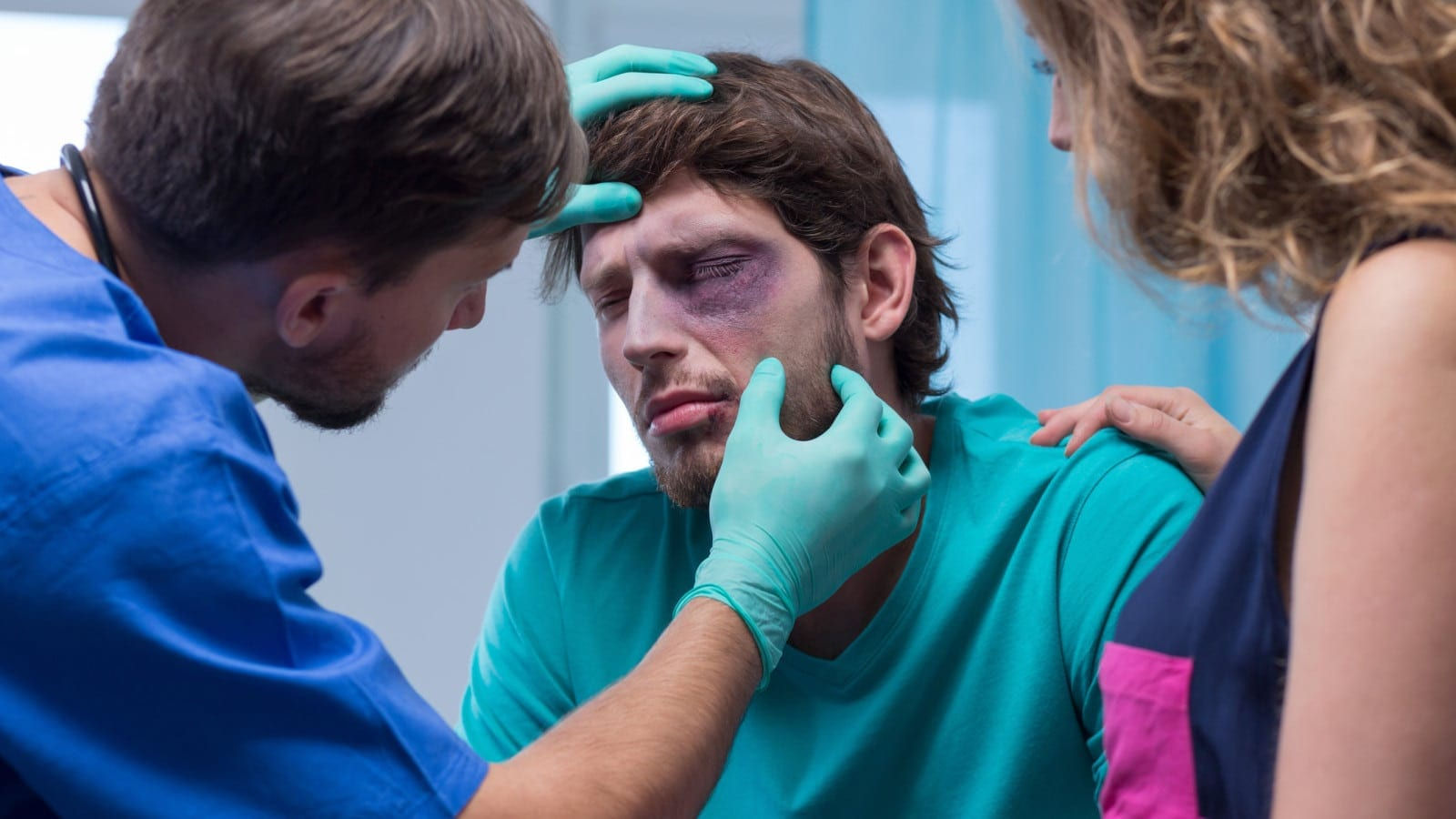 Man Having His Eye Examined By A Male Nurse Stock Photo
