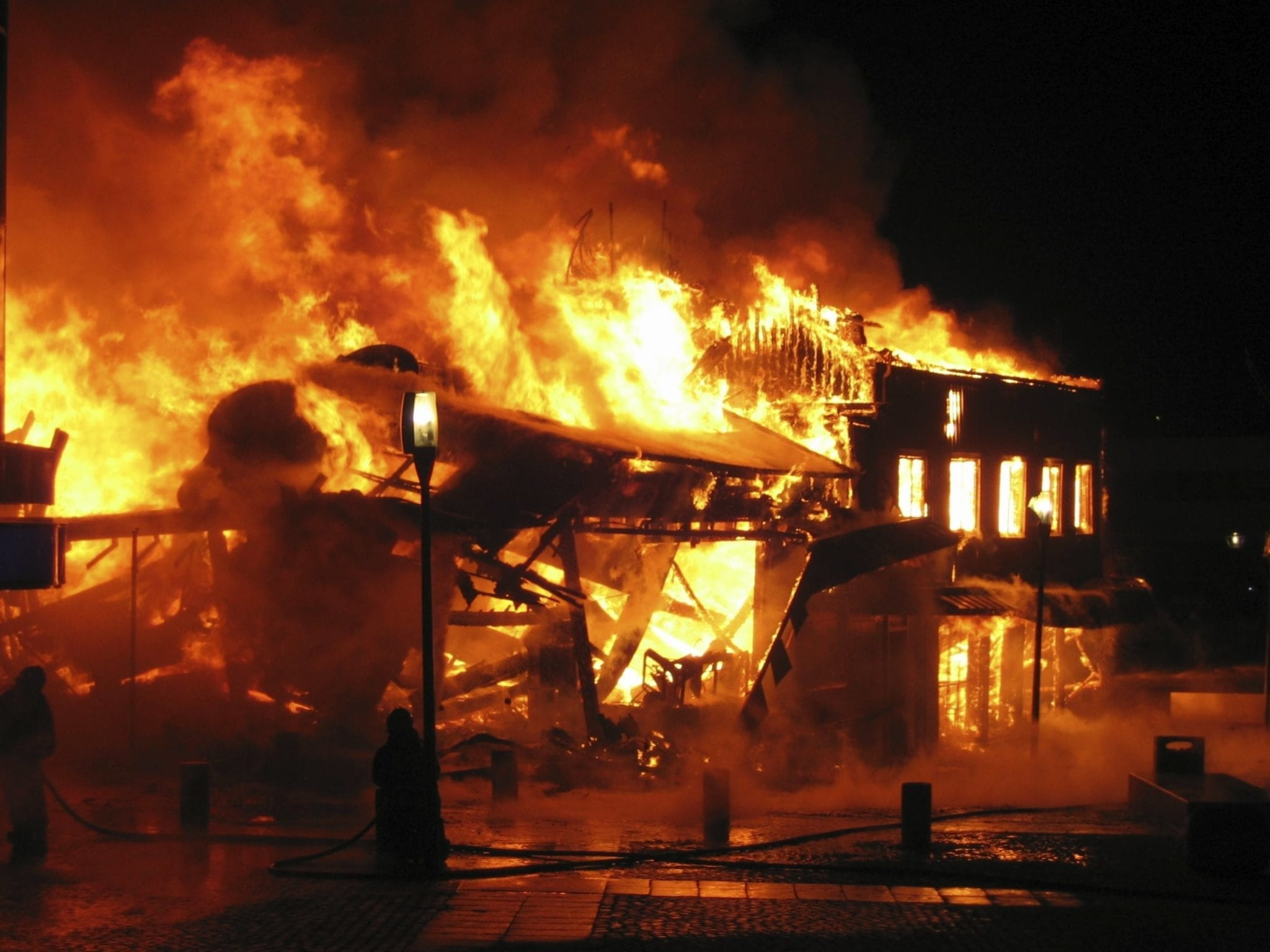 Motel On Fire At Night Stock Photo