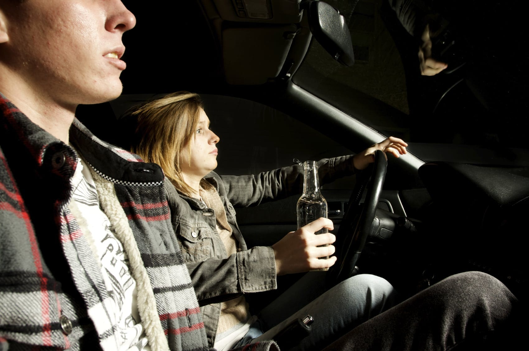 Young Teens Drinking While Driving Stock Photo