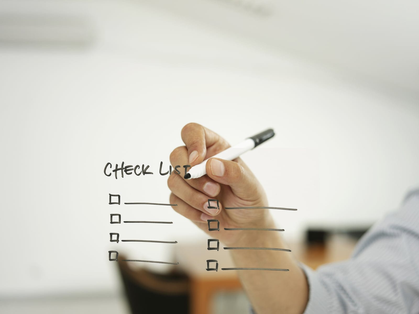 Man Making A Checklist Stock Photo
