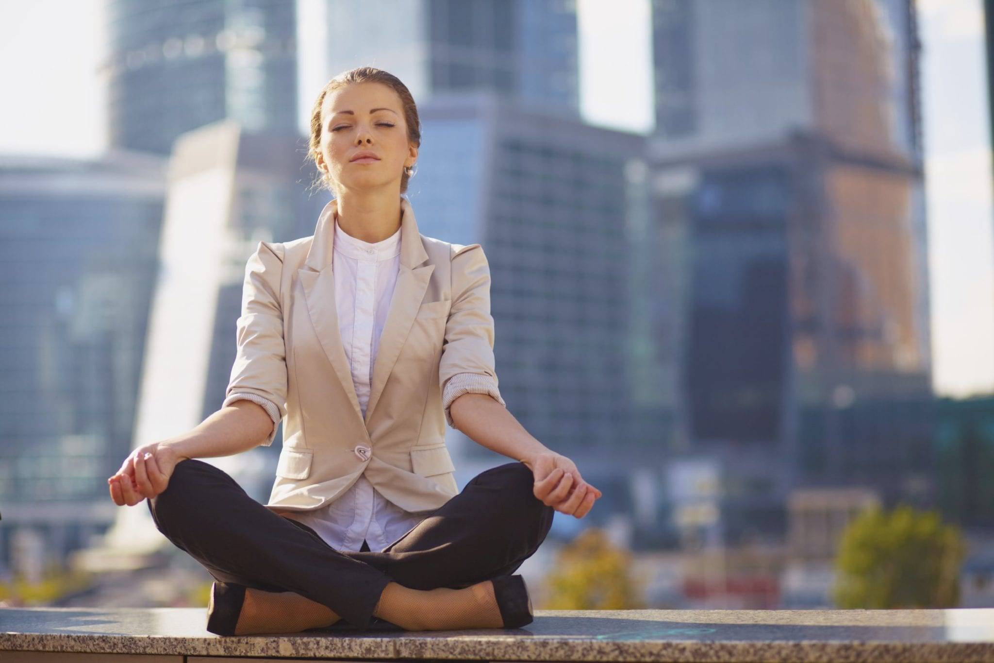 Young Woman Practicing Meditation Stock Photo