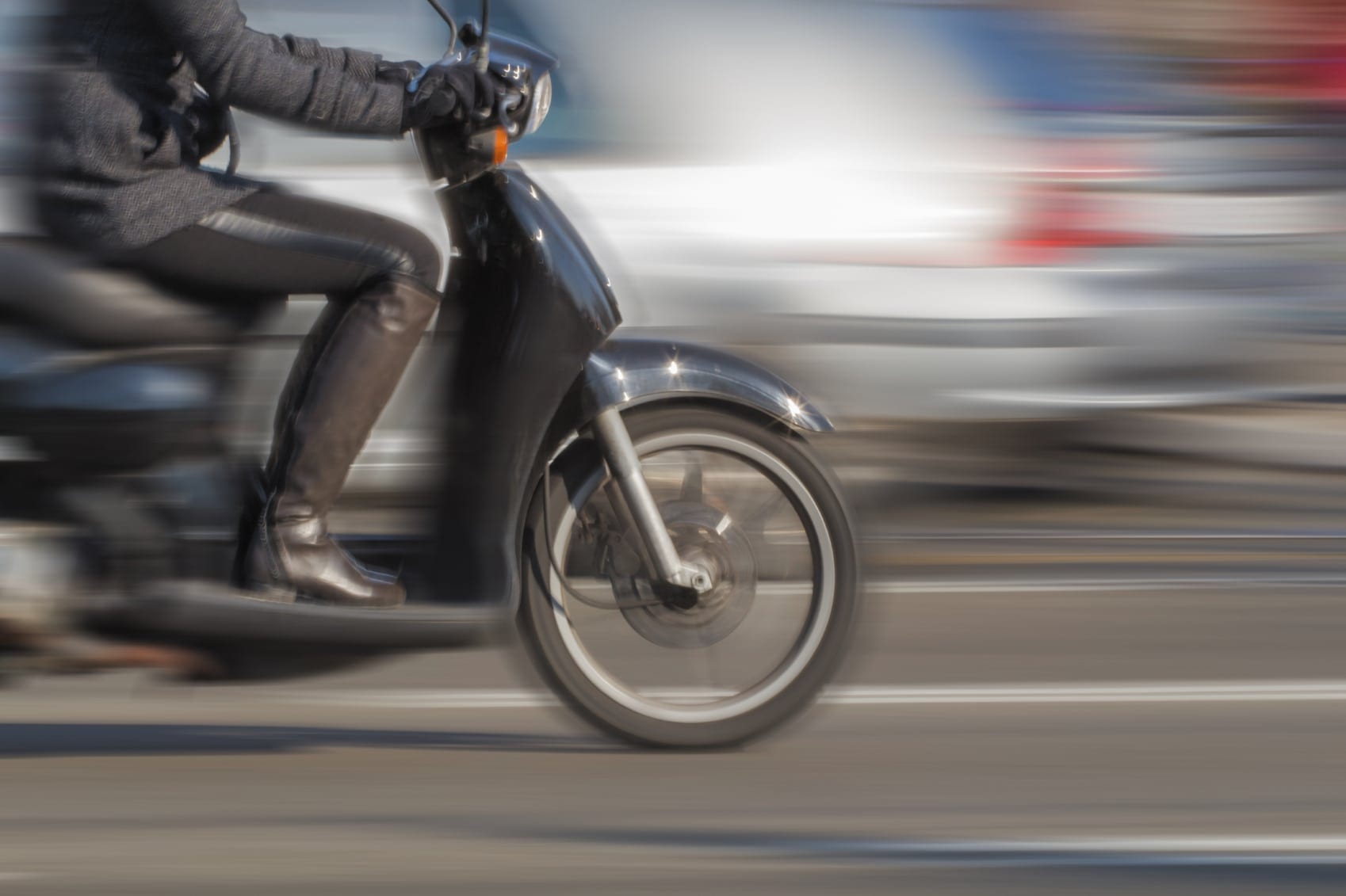 Man Riding Motorcycle In City Stock Photo