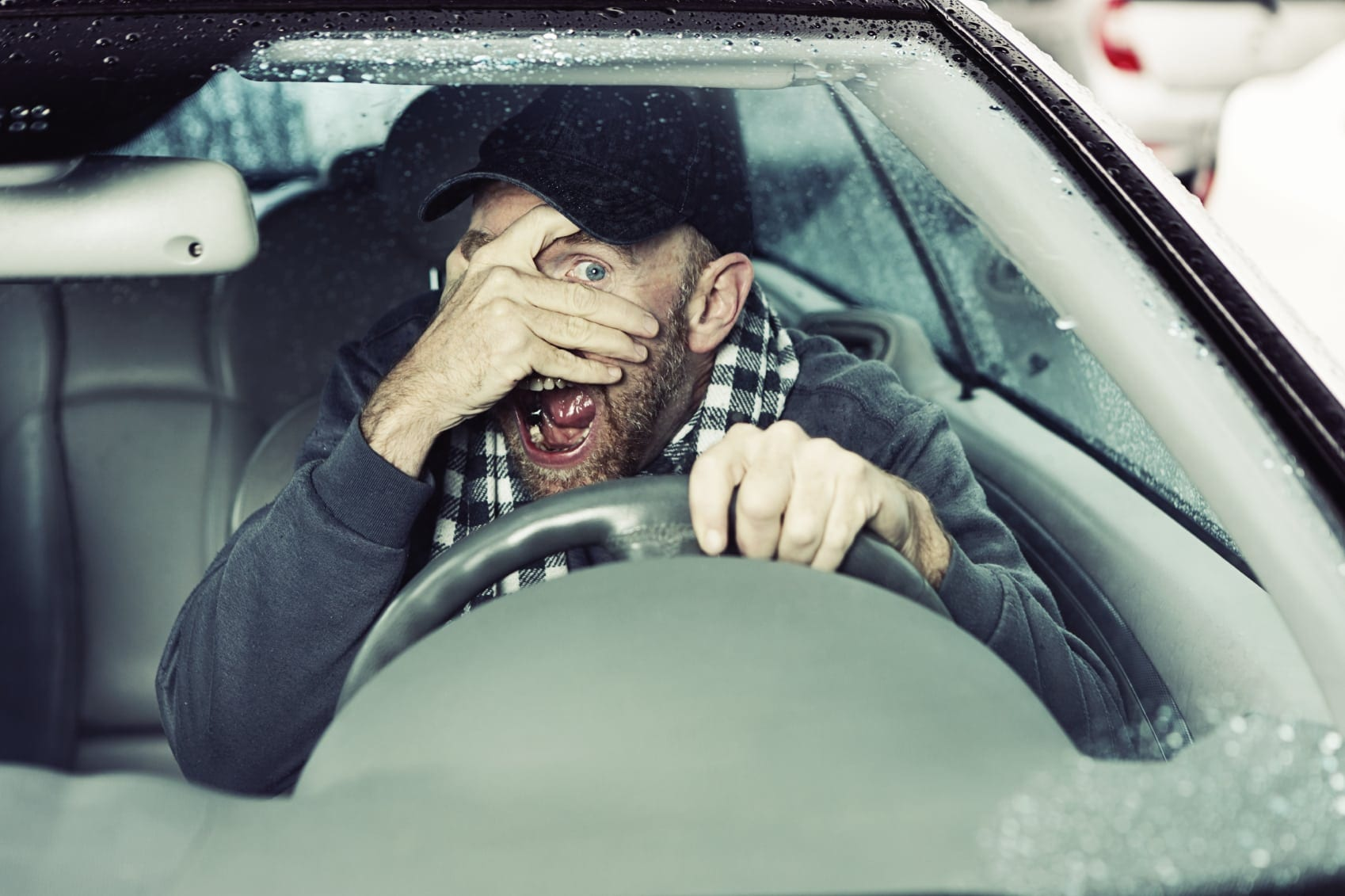 Man Being Blinded By The Sun While Driving Stock Photo