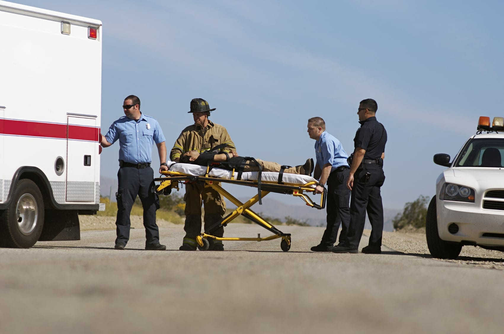 Accident Victim Being Loaded Into Ambulance Stock Photo