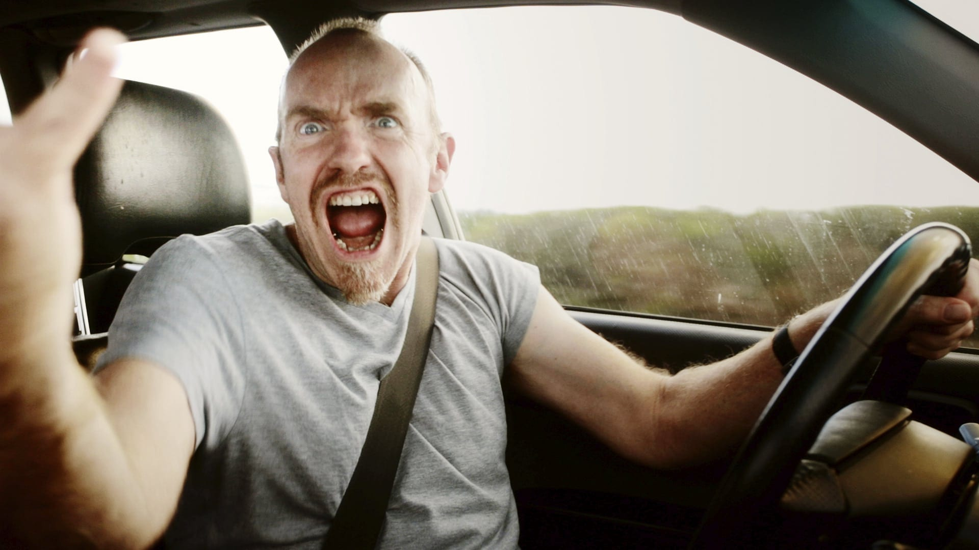 Man Shouting And Expressing Anger While Driving Stock Photo