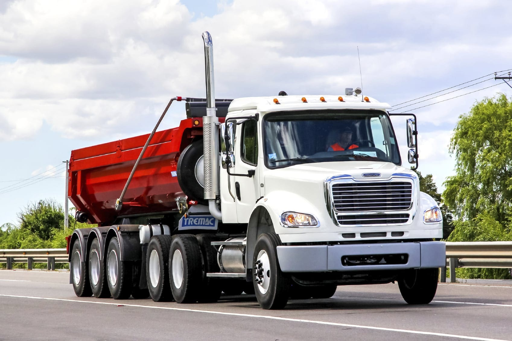 Large Semi-truck Driving On A Rural Road Stock Photo
