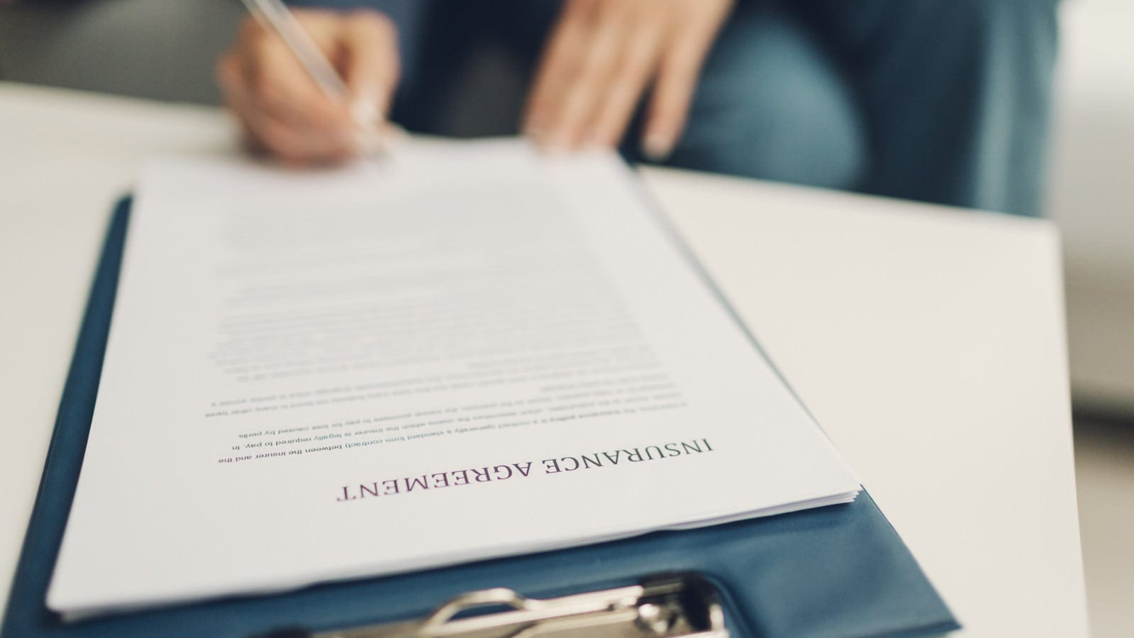Signing An Insurance Agreement Stock Photo
