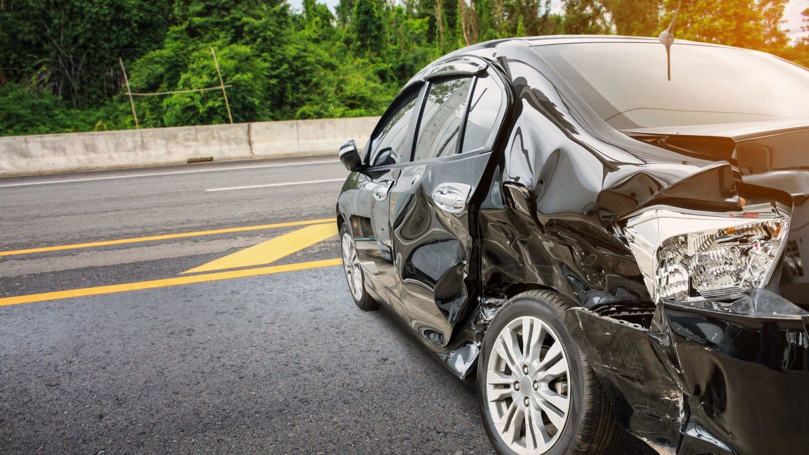 Black Car With Severe Structural Damage Stock Photo
