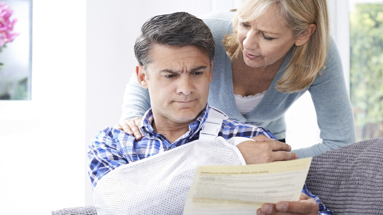 Married Couple Examining A Bill Or Statement Stock Photo