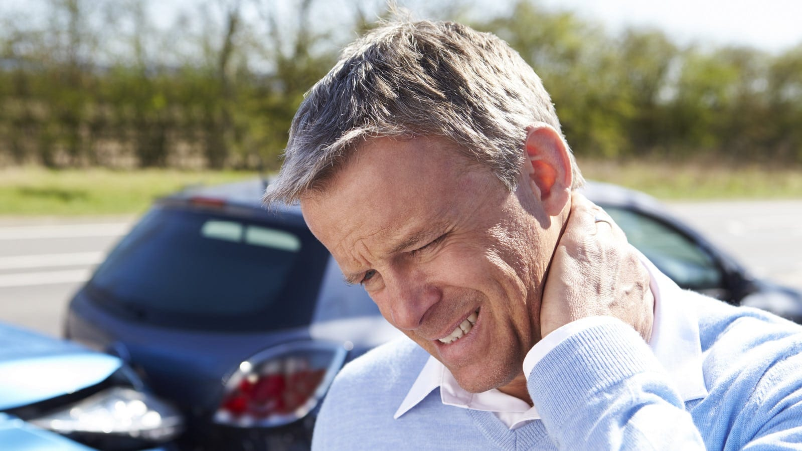 Man With Neck Injury After Car Accident Stock Photo