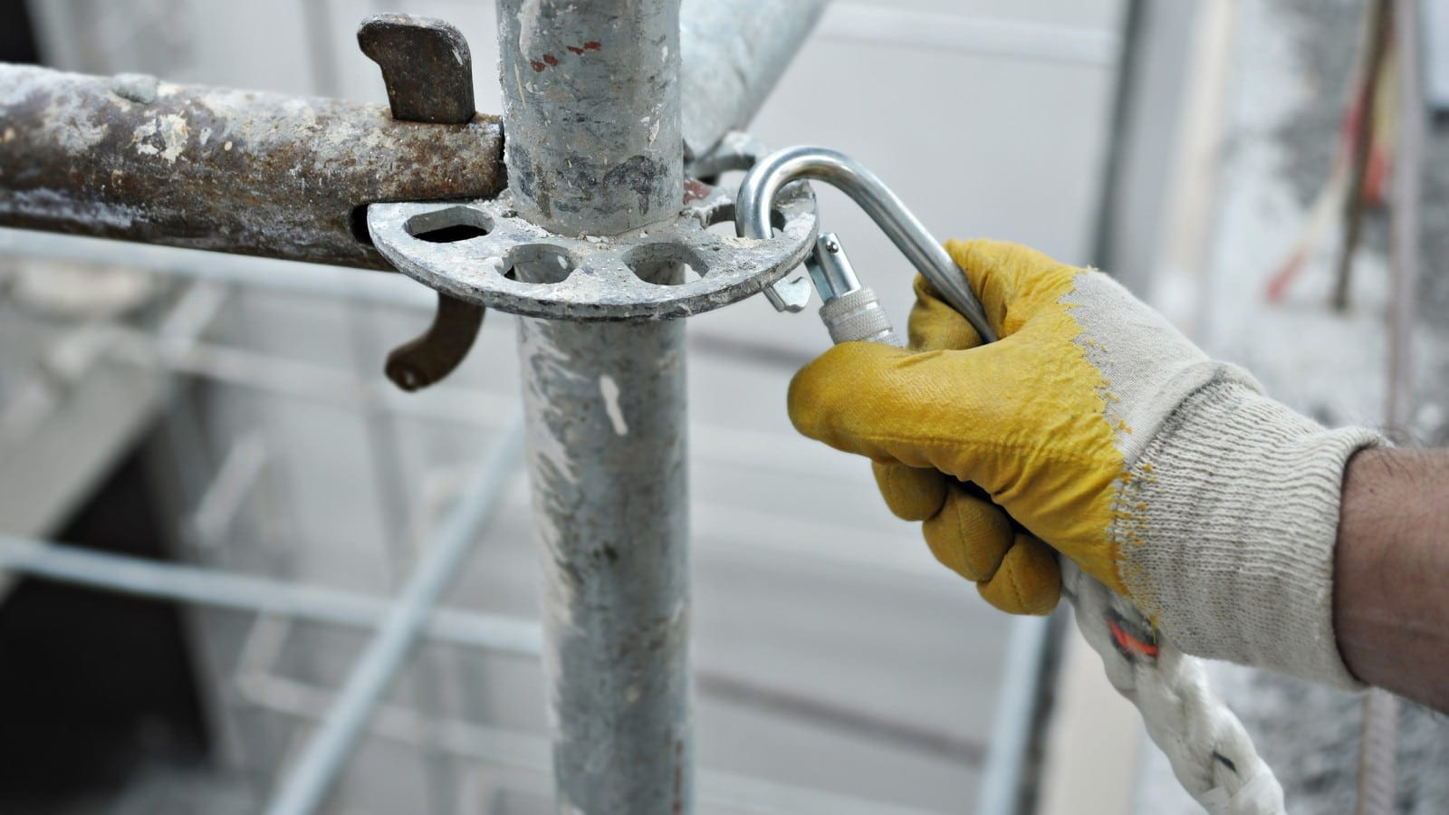 Construction Worker Working On Scaffolding Stock Photo
