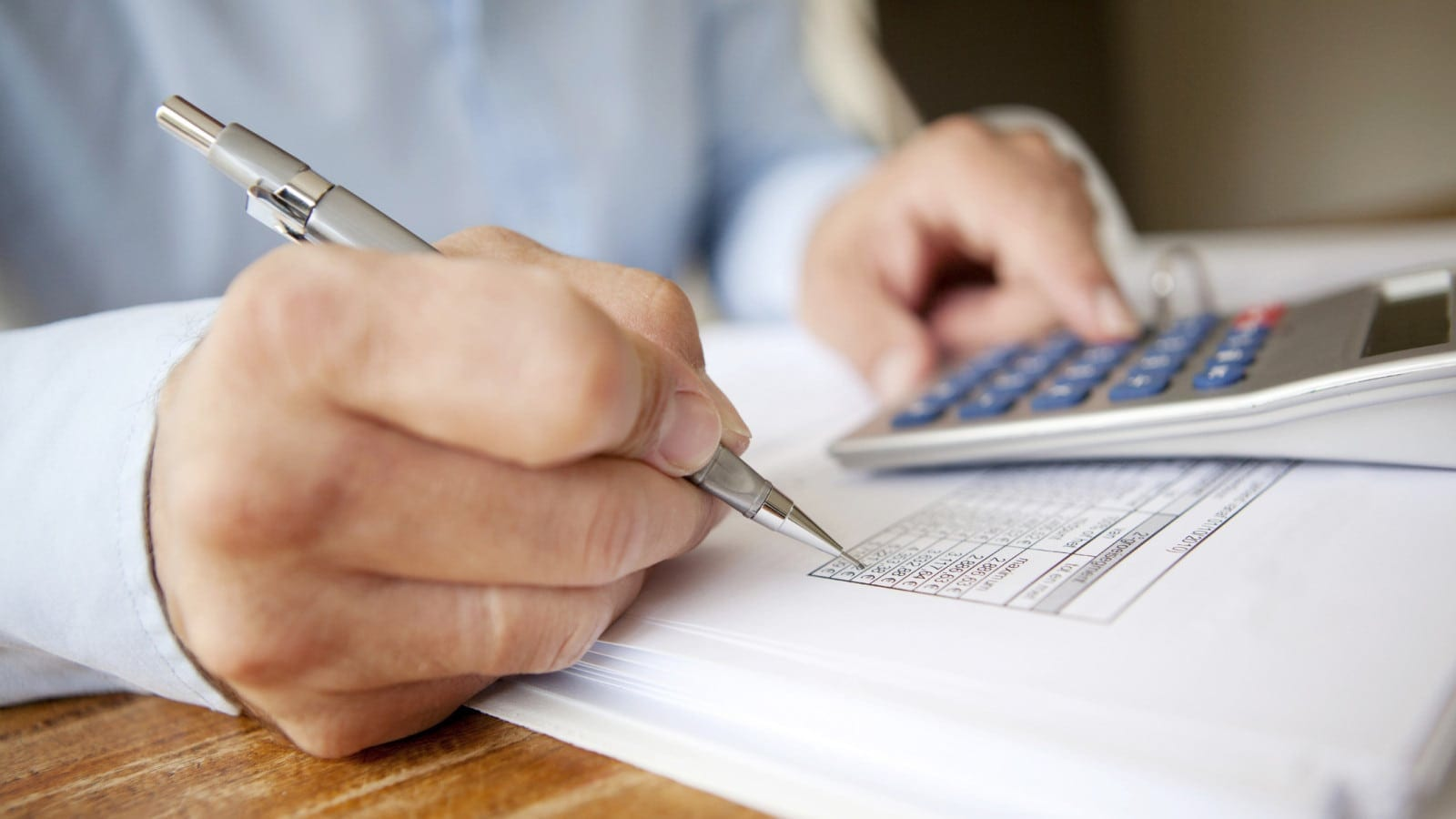 Man Working With A Calculator Stock Photo