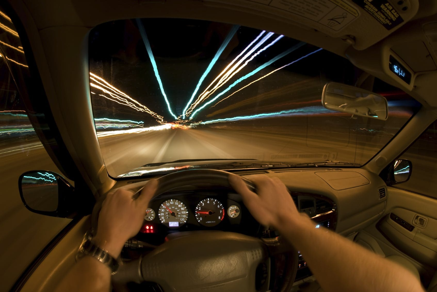 Man Speeding In His Vehicle At Night Stock Photo