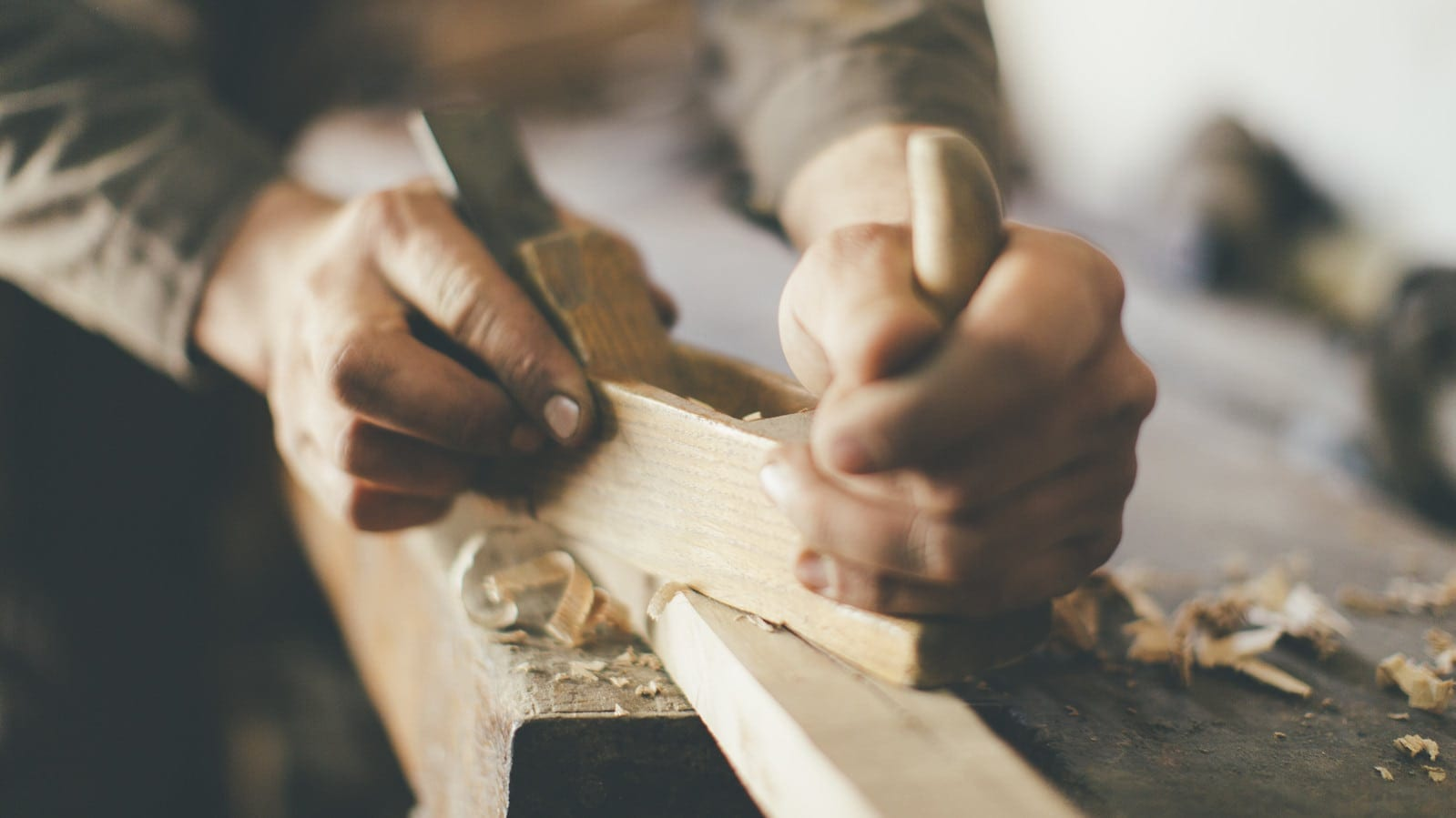 Man Cutting Wood Stock Photo