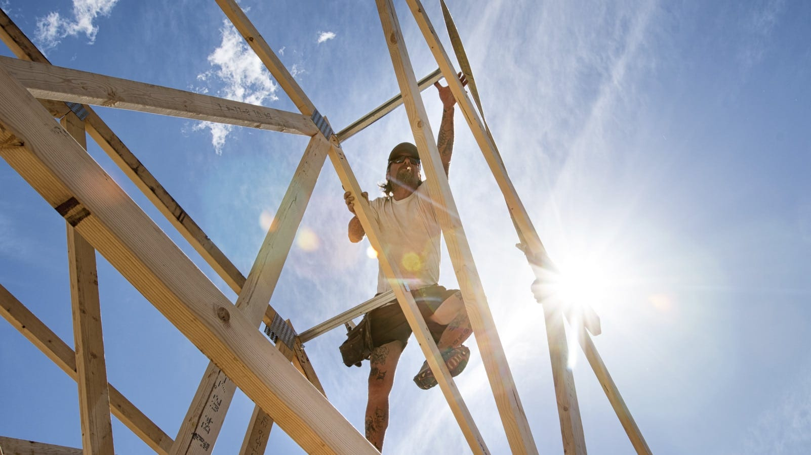 Construction Worker Building A Home Stock Photo