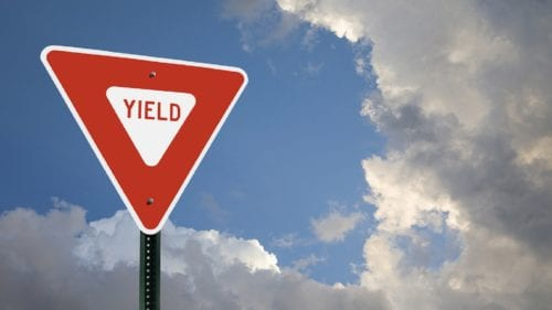 Yield Sign With Clouds Stock Photo