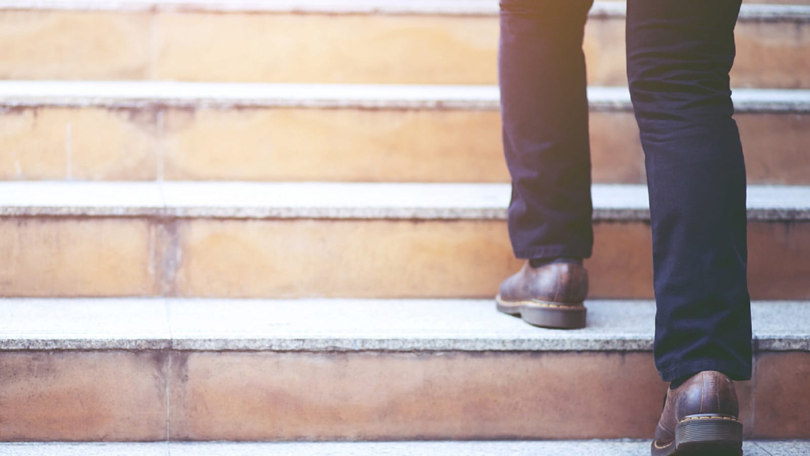 Man Climbing Stairs Stock Photo