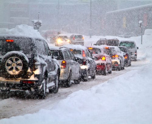 cars-stopped-in-blizzard-on-road