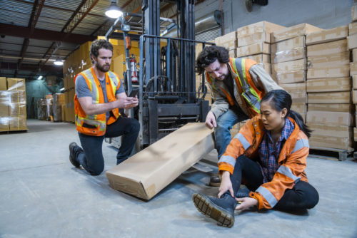 a female warehouse worker injured on the job by a forklift