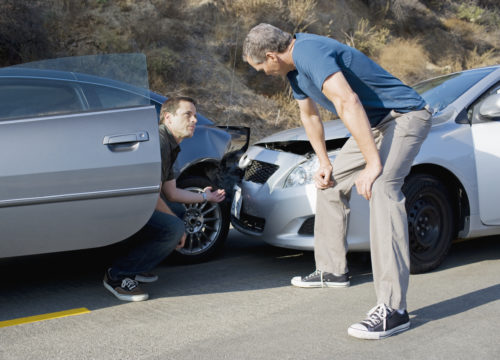 two drivers arguing over fault after a car accident outside of Colorado Springs