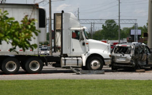 The scene of a truck accident at an intersection.